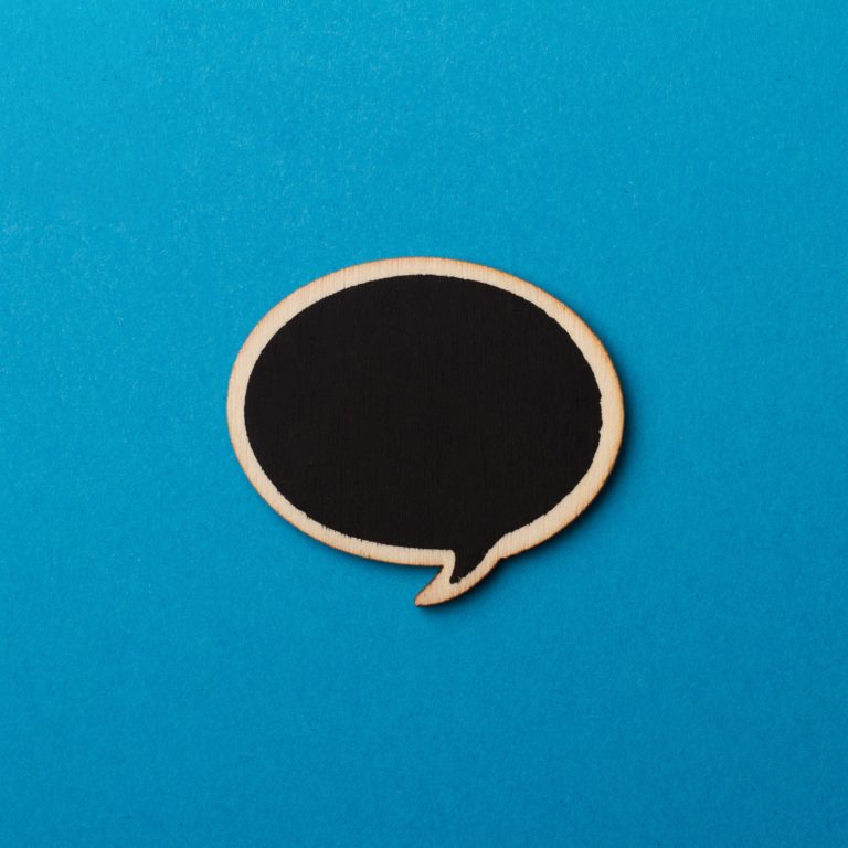 Close up of black wooden blank speech bubble
